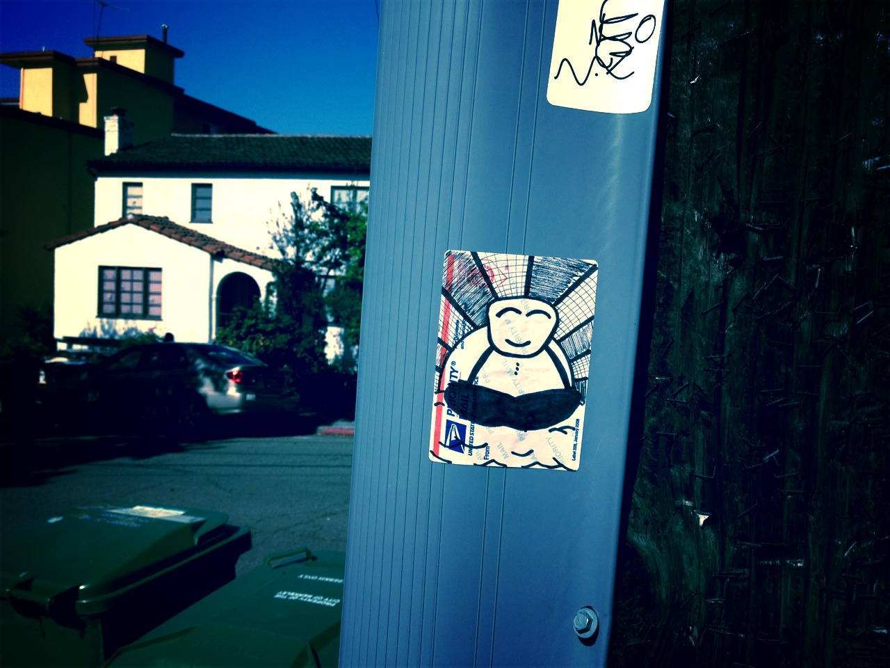 Random Buddha sticker on a telephone pole in Berkeley.